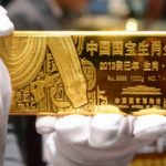 Gold trades lower on Fed stimulus outlook, China, India demand