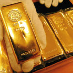 Gold futures swing on Fed tapering bets, weaker dollar supports