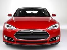 Tesla beat estimates as shares jump 14%