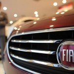 Fiat Chrysler Automobiles NV's share price down, to sell its stock at a 4% discount, places offering at $11 per share