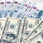 Forex Market: USD/RUB rebounds from three-week lows following Fed taper decision
