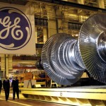 General Electric Co.'s share price down, posts second-quarter profit that matches analysts' forecasts, prepares Synchrony IPO