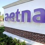Aetna shares touch a fresh all-time high on Thursday, quarterly earnings beat expectations, full-year forecast revised up