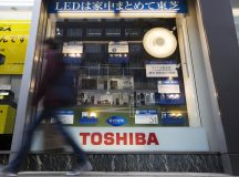 """Toshiba shares retreat a seventh straight session on Thursday, the company's rating downgraded further into """"junk"""" territory by Moody's"""