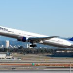 Delta Air shares close slightly higher on Tuesday, first-quarter unit revenue growth to slow further, airline forecasts