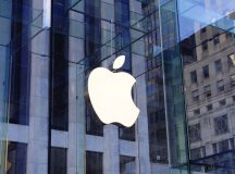 Apple shares close lower on Friday, Katherine Adams appointed as company's new general counsel