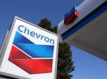 Chevron shares gain the most in 1 1/2 weeks on Friday, first-quarter earnings top estimates as crude prices rise