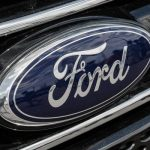 "Ford shares close higher on Tuesday, Piper Jaffray downgrades the stock to ""Neutral"", cuts price target"
