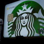 Starbucks shares fall for a third straight session on Monday, company launches Starbucks Rewards Visa Prepaid Card