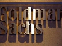 Goldman Sachs shares close lower on Tuesday, second-quarter earnings top estimates as investment banking, fixed income trading support