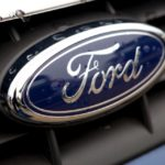 Ford shares close lower on Wednesday, auto maker informs British PM May of its plans to relocate production