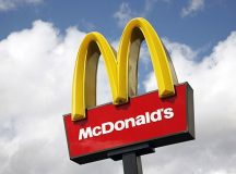McDonald's shares hit a fresh all-time high on Friday, second-quarter comparable sales top estimates supported by new promotions, renovated stores