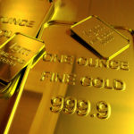 Gold at three-week low on stronger dollar, Fed stimulus outlook in focus