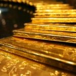 Gold erases earlier gains on stronger dollar