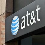 AT&T share price down, to acquire NII Holdings' wireless business