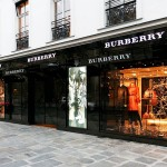 Burberry Group Plc' share price down, reports slowing sales growth and posts warning of slight downward pressure on margins