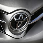 Toyota Motor Corp.'s share price down, reveals its renewed 2015 Camry Sedan at the International Auto Show to maintain market position