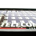 Telecom Italia SpA's share price down, reports a 7.6% decline in first half earnings