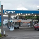 Chevron Corp.'s share price rises, to sell a 30% stake in Canada at the price of $1.5 billion to a subsidiary of Kuwait Foreign Petroleum Co.