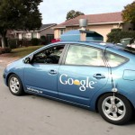 Google share price down, boosts efforts in self-driving vehicles
