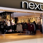 Next share price down,  projects lower sales growth
