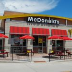 McDonald's shares gain for a second straight session on Thursday, burger chain plans another round of layoffs, WSJ reports
