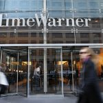 Time Warner shares close lower on Wednesday, company's quarterly earnings exceed market expectations as blockbuster movies support
