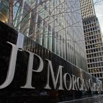 JP Morgan Chase shares close lower on Tuesday, bank to settle swap rate rigging case