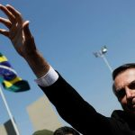 Boeing shares close higher on Friday, company could take over Embraer's entire commercial aviation business, Brazil's Bolsonaro says