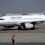 United Air shares close little changed on Monday, air carrier acquires stake in security identity firm Clear
