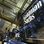 Goldman Sachs shares close lower on Monday, group to merge private-investing units, WSJ reports