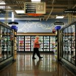 Kroger shares close lower on Friday, company's full-year forecasts on comparable sales and earnings top analyst estimates