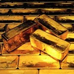 Gold futures fluctuate near 1-week high on Fed stimulus outlook