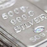 Silver extends gains, tracks gold higher